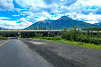 Bridges carrying the Trans-Canada Highway over the Bow Valley Parkway and the Bow River, with the Sundance Range to the southwest.