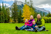 Jenn, Walter, James and Shawn in Central Park in Banff with Mount Rundle in the background.