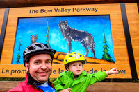 Shawn and James checking out the wolves on the sign for the Bow Valley Parkway.