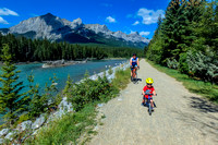 Shawn and James cycling along the river in Canmore.