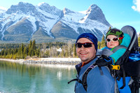 Shawn and James on the shore of the Bow River, with the Mount Lawrence Grassi massif beyond.