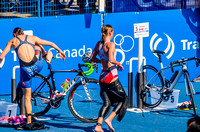 Alice Betto (ITA) and Kirsten Sweetland (CAN) in the transition from swim to bike.