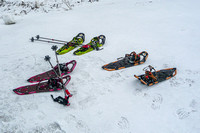 Our snowshoes laying on the ground.
