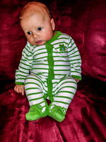 James sitting on the couch in his froggy pyjamas. This was the first time he smiled!