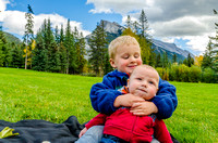 James and Walter in Central Park in Banff with Mount Rundle in the background.