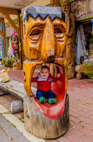 James in a wooden sculpture in Kimberley.