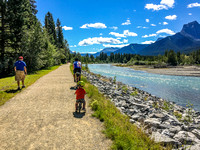 James and Shawn cycling along the trail near the Bow River.