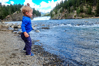 James had a great time throwing rocks into the river near Bow Falls!
