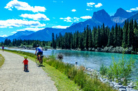 Shawn and James cycling along the trail next to the Bow River.