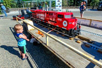 James looking at a 1/8 scale model train.